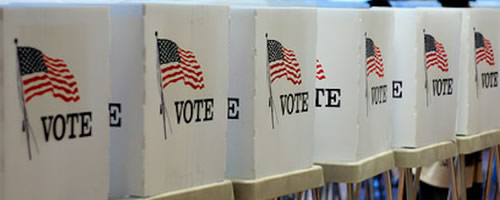 voting booths with American flag and and word vote on them